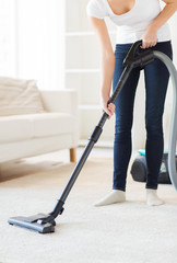 close up of woman with vacuum cleaner at home