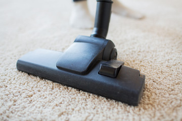 close up of vacuum cleaner cleaning carpet at home