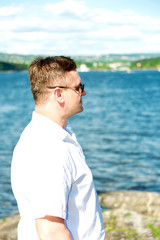 Man portrait with sea on background