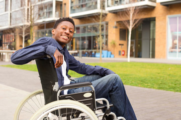 a happy young man in a wheelchair.