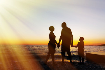 Family vacation. Sunset at sea. Silhouette