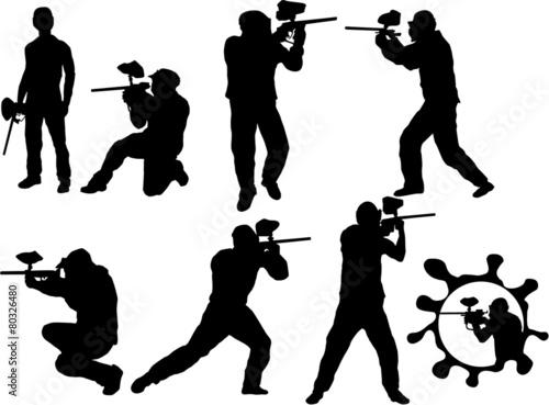 Fototapeta Paintball players silhouette