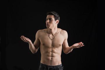 Charismatic muscular man shrugging his shoulders