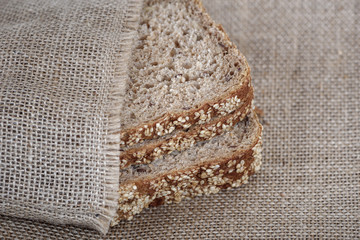 Sliced brown bread close-up.