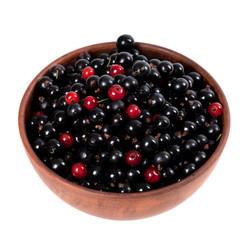 Blackcurrants and redcurrants in ceramic bowl