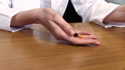 Woman Taking A Pill From The Table