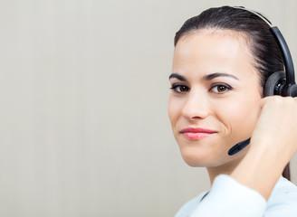 Female Call Center Employee Using Headset