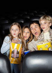 Shocked Family Watching Film In Theater