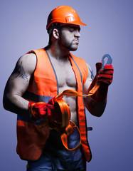 Strong men worker in the helmet