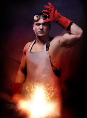 Worker men: blacksmith or welder with fireball