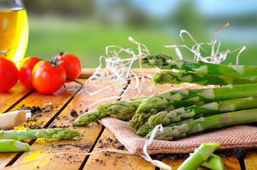 Freshly picked asparagus on a table in the field