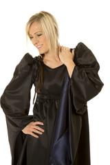 woman in black cloak smile look down