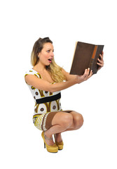 young sexy attractive woman reading old book