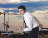 Determined businessman running and cityscape background poster