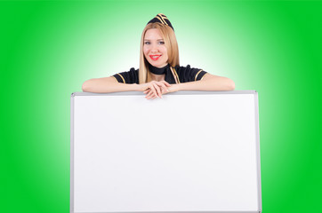 Woman stewardess with blank board
