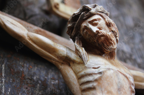 Tuinposter Standbeeld Holy cross with crucified Jesus Christ (fragment)