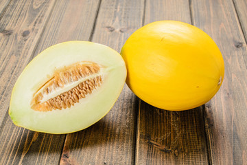yellow melon on the wooden board