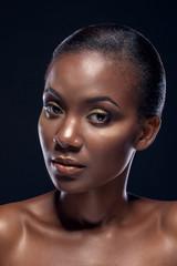 Beauty portrait of handsome ethnic african girl, on dark backgro