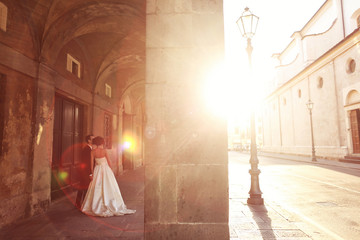bride and groom in the city on a sunny day
