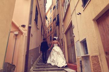 bride and groom on a narrow street