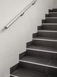 Leinwanddruck Bild - Moderne gekachelte Treppe mit Handlauf aus Edelstahl