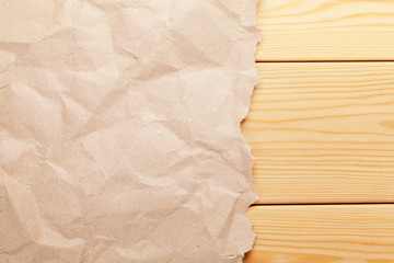 Cardboard paper over wooden background
