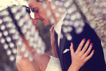 close up of groom and bride kissing