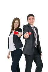 Smiling woman and man giving red business cards