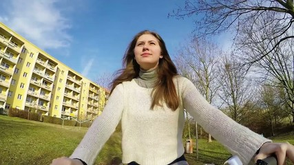 Girl riding bike, action camera