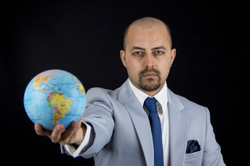 man holding world in his hand, save the planet