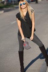 Beautiful stylish girl standing on the road