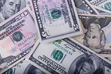 Different dollar banknotes as a background close-up