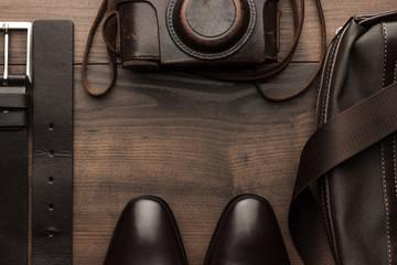 brown shoes, belt, bag and film camera frame