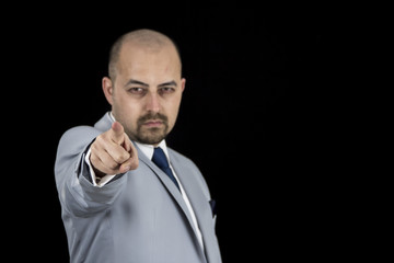 succesful businessman pointing at you