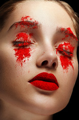 Face art makeup. Woman in red powder