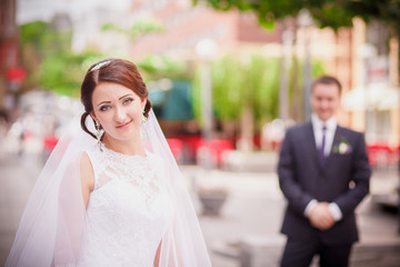 bride and groom blurred