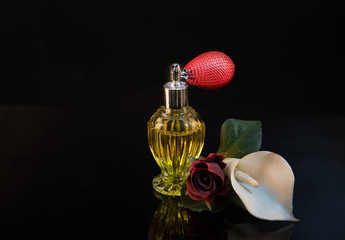 Perfume bottle with atomizer, red rose and cali flower