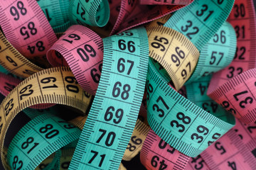 Colorful measuring tapes pile