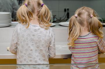 children cooking rear view