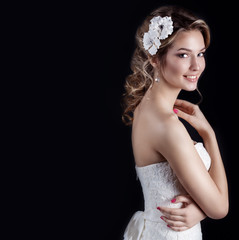 smiling woman with stylish hairstyle with white flowers in hair