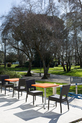 View of a coffee terrace in the garden with tables and chairs