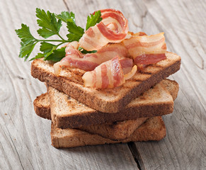 hot big sandwich, toast and bacon with parsley