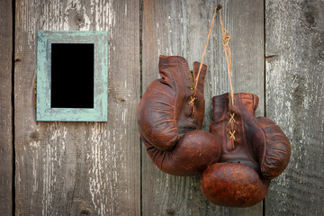 Old boxing gloves and frame for photo
