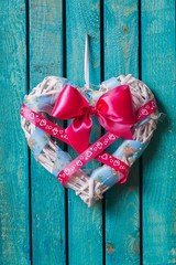 Wall. Rustic heart decoration hanging from hook on wood panel