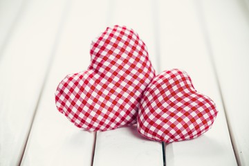 Valentin. valentines day background with two hearts on wooden