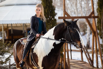 Young young girl goes on a brown horse