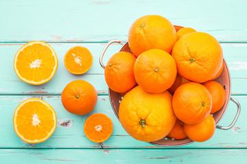 Oranges and Tangerines in retro colander.