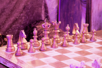 Retro vintage chess in night private club. Blue and violet light