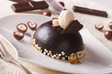 Delicious chocolate cake with nuts, topped with macaroon
