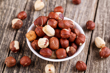 Hazelnuts on a white plate.